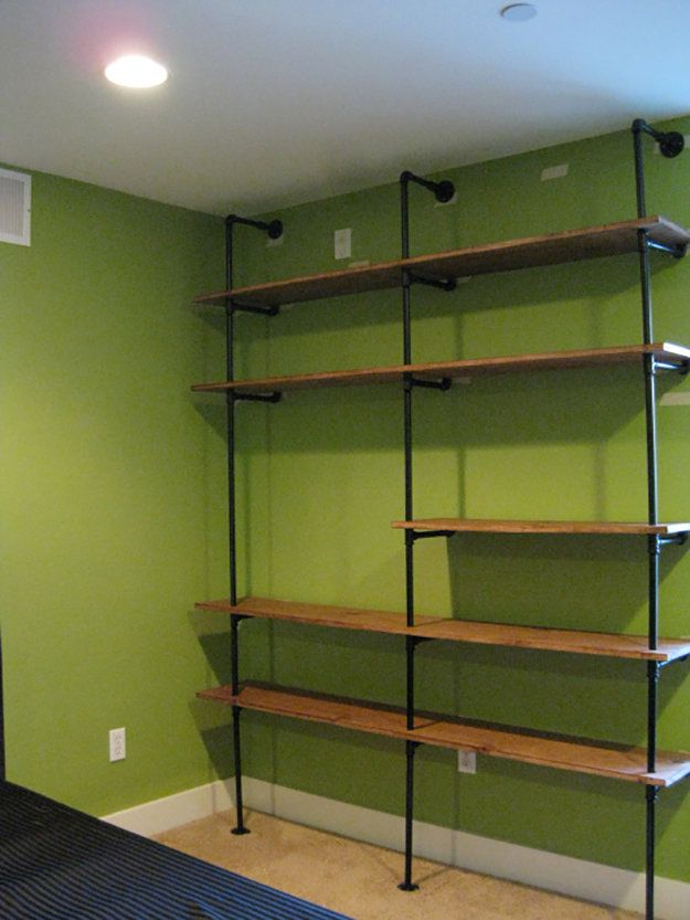 Book Shelf Made Out Of Pipe Clamps | Man Cave Ideas | 19 DIY Decor and Furniture Projects | Cool And Unique Projects by DIY Ready at http://diyready.com/man-cave-ideas-19-diy-decor-and-furniture-projects/