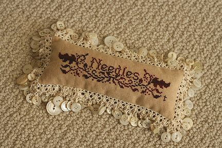 pleasentree~日々の楽しみ: And more... needle pillow with lace and antique mother-of-pearl buttons