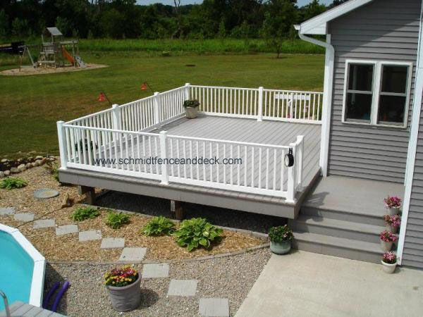 White and gray decks this picture shows a large azek for Grey decking garden ideas