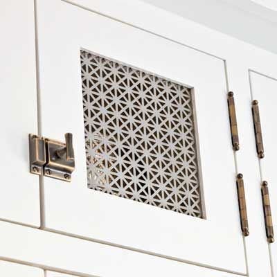 Perforated-metal panels reinforce the Craftsman look and play off latches with a finish in Burnished Antique. |  Photo: John Granen