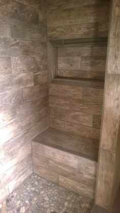 Master Shower with bench and window for soap/shampoo. River rock floor, along with Montagna rustic barn tile on the sides.