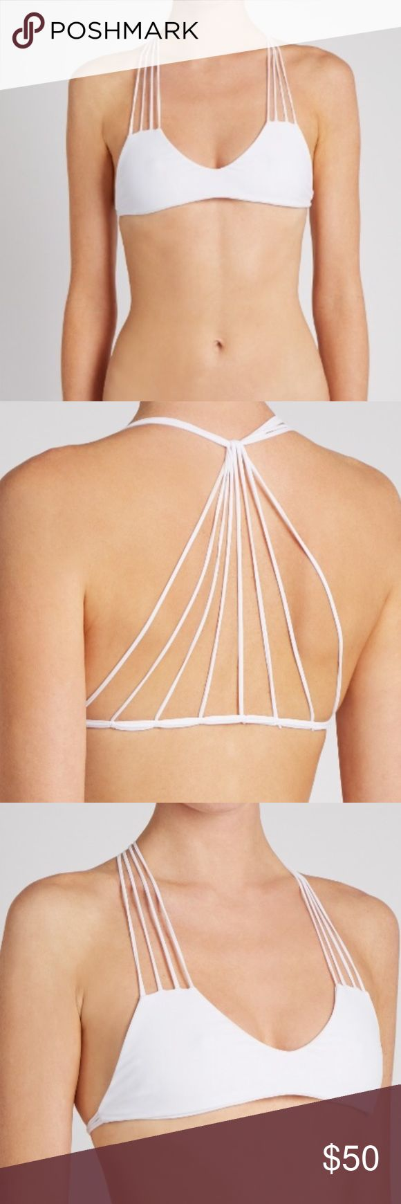 • banyans string back bikini top • This white Banyans bikini top is a sleek example: it's cut to a scoop-neck shape and suspended from multiple strings that knot at the back. Team it with the matching briefs poolside. White, stretch fabric V-neck, multi-string shoulder straps Multi-string back, knotted back-strap detail White stretch-fabric lining Designer colour: Foam 80% nylon, 20% spandex. Hand wash Mikoh Swim Bikinis