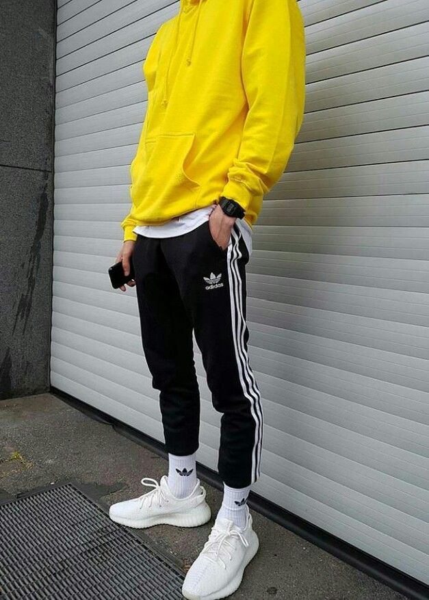 The socks, joggers, and plain yellow hoodie that color. (Socks and pants online at adidas) I think called trefoil joggers/socks