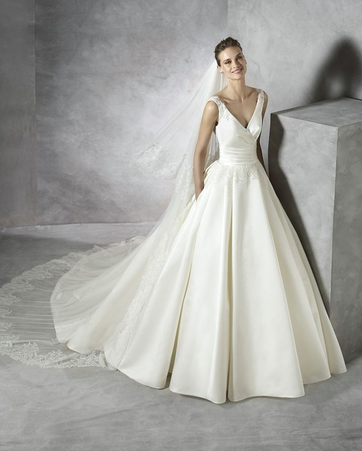 Wedding Dresses, Bridesmaid Dresses, Prom Dresses and Bridal Dresses Pronovias Wedding Dresses - Style Tesira [Tesira] - Pronovias Wedding Dresses, 2016. Royal Satin, Chantilly, Lace & Guipur V-neck ballgown with pockets. Pictured Veil is not included.