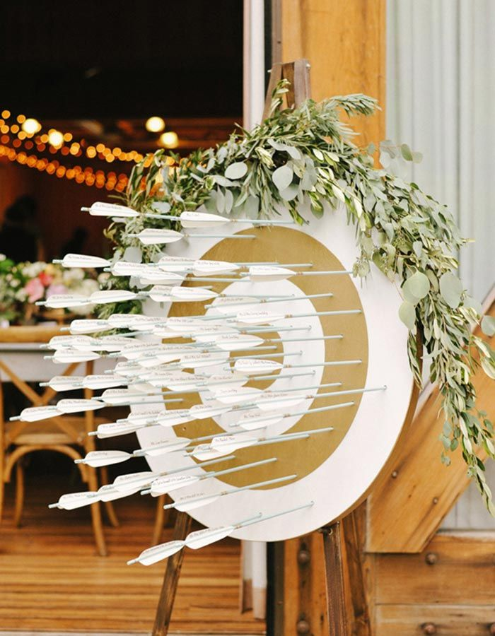 Add some creativity to your reception tables with this dart board escort card holder at your wedding!