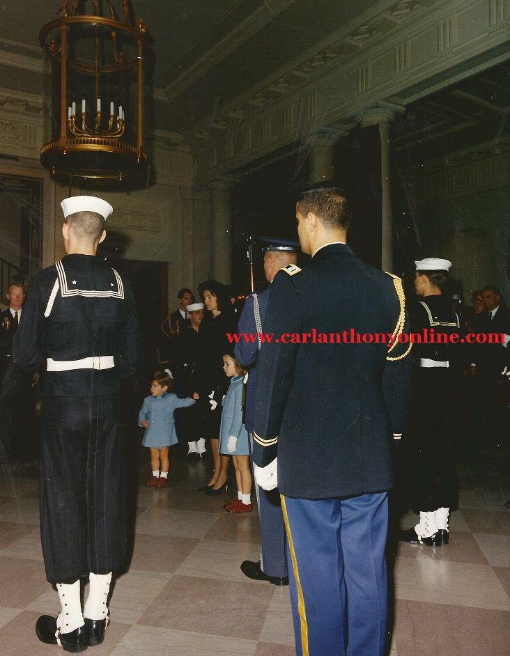 Jacqueline Kennedy with her children, President Lyndon Johnson at far right, in the White House North Entrance Lobby before the late President's public funeral ceremonies began.