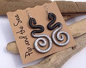 Glittery curly eco-resin earrings in black and silver on allergy-friendly surgical steel hooks