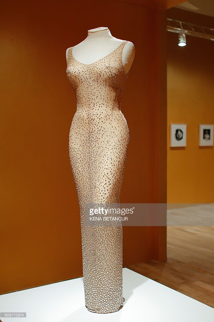 Former actress Marilyn Monroe's iconic 'Happy Birthday Mr. President' dress is viewed during a press preview at MANA Contemporary Museum in Jersey City, New Jersey on September 22, 2016. Julien's Auctions is offering the sequined dress for auction in Los Angeles on November 17, 2016. / AFP / KENA