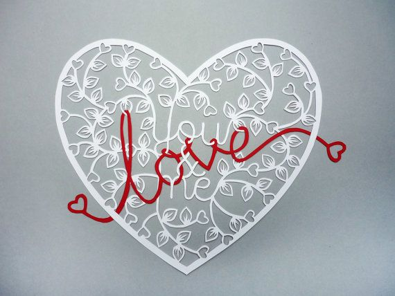 Papercut heart with love text