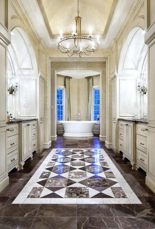 There's something about a bath tub centered at the end of a big long room