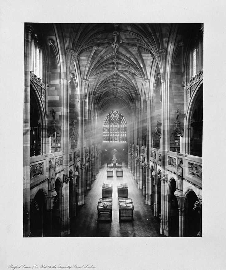 August: Interior of the reading room, west side, taken from the Gallery, of The John Rylands Library by  Bedford Lemere and Co.