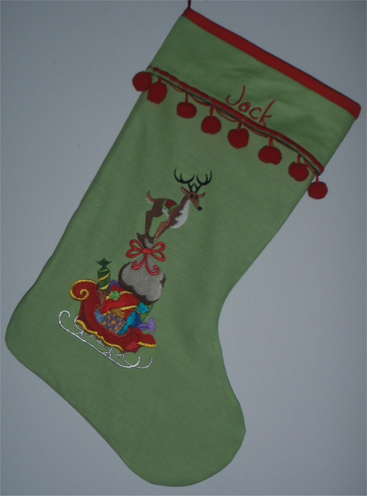 201654 - Christmas stocking - machine embroidered reindeer stack.  Personalised.  red bobble trim, dark green lining. SOLD. Can be ordered