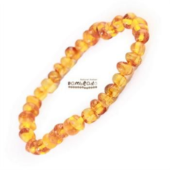 This may be an alternative to help you with arthritis, eczema and general aches and pains. This Honey 18cm Bambeado bracelet is made from rounded bud amber beads that have been smoothed so that there are no sharp edges. The bracelet is approx 18 cm in length and is threaded onto elastic to stretch over your wrist.While Bambeado amber comes in several colours, the colour is just a matter of personal choice.