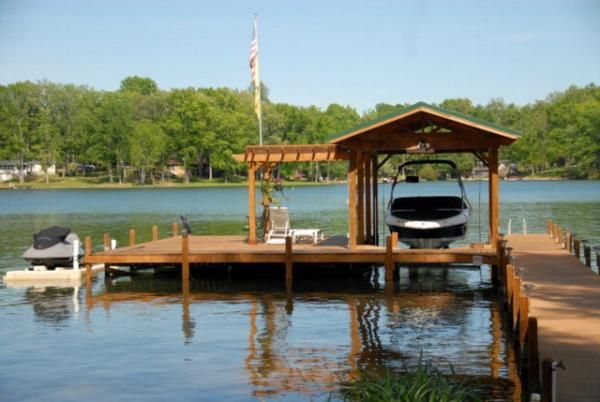 (This boat dock is from a home that was previously for sale on Lakehouse.com) The dock extends 95 ft into deep water and features extra large 20'x29' dock platform, ideal for outdoor meals, fishing or just relaxing and sunning. The covered boat slip has a heavy duty (6000Lb) rated powered boat lift and will accommodate larger boats or pontoons. Beautiful Log Home Retreat on Lake Greenwood SC