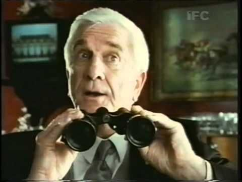 "Red Rock Draught Cider commercial with Leslie Nielsen.  In 1990, a series of TV adverts, directed by John Lloyd were produced in the style of Police Squad!, and starred Leslie Nielsen in a role similar, but not namechecked as Detective Frank Drebin. In one of these, Nielsen shouts, ""Hey! You, over there, in the shadows!"" The man steps forward and reveals himself to be Hank Marvin, guitarist with sixties pop group, the Shadows."