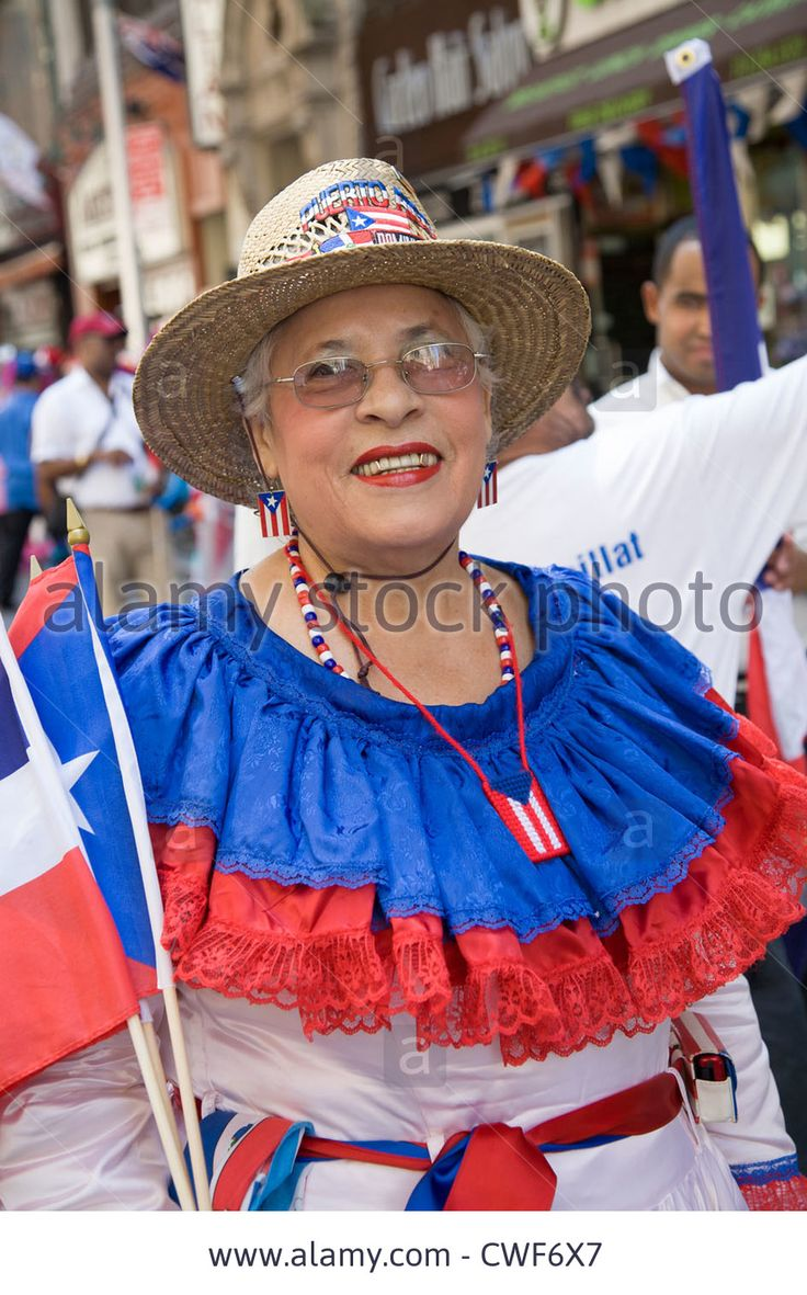 Patriotic woman wears the colors of the Dominican flag at the Dominican Day Parade on 6th Ave. in New York