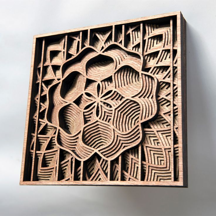 "Oakland-based artist Gabriel Schama works with mahogany plywood to create intricate relief sculptures that ""twist, intersect, and overlap to create various mandala-like forms"".   More art on the grid via Colossal"