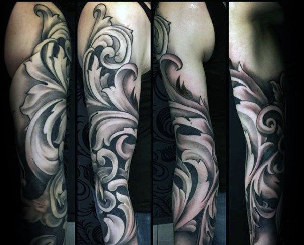 Gentleman With Full Sleeve Tattoo Of Filigree Design