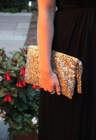 TIQUE Gold sequinned clutch bag
