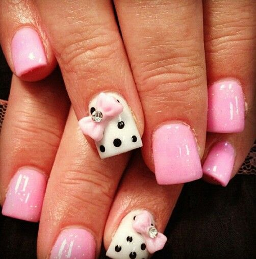 Pink nails with a bow.