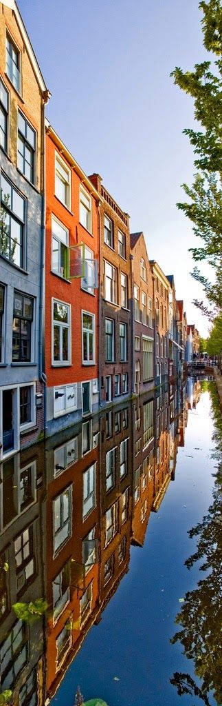 Reflections of homes in a canal of Delft, Netherlands