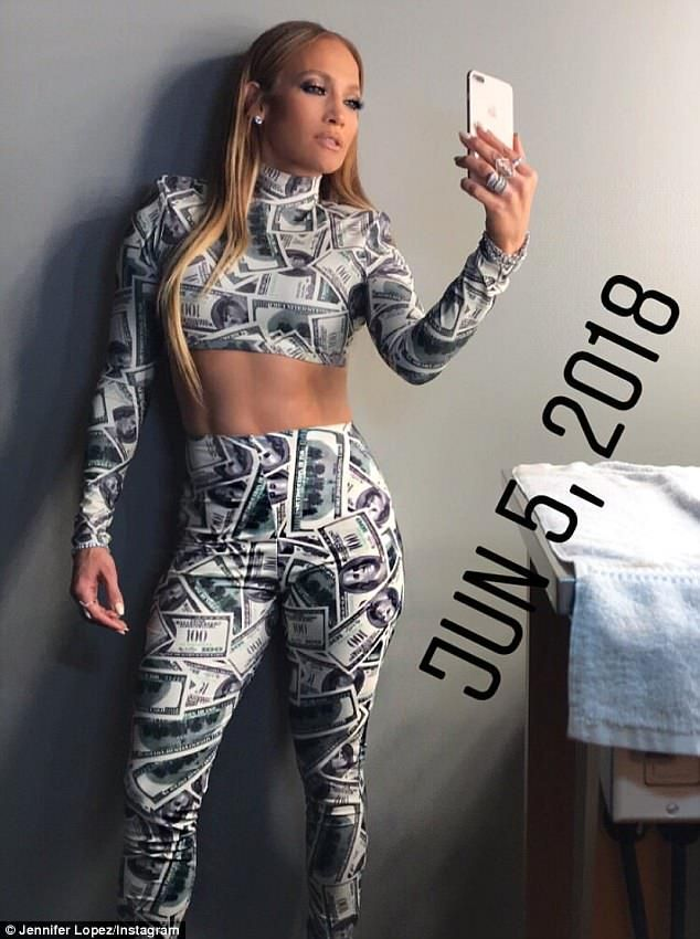 c3064937ff107f Big bills: Jennifer Lopez appeared on Jimmy Kimmel Live on Wednesday in a  Dinero outfit of a cropped top and leggings with a $100 bill print