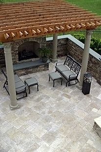 French Pattern Travertine Patio With Dry Stack Stone Faced Fireplace And  Walls