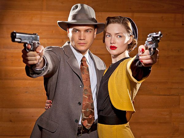Emilie Hirsch and Holliday Grainger as Clyde Barrow & Bonnie Parker.