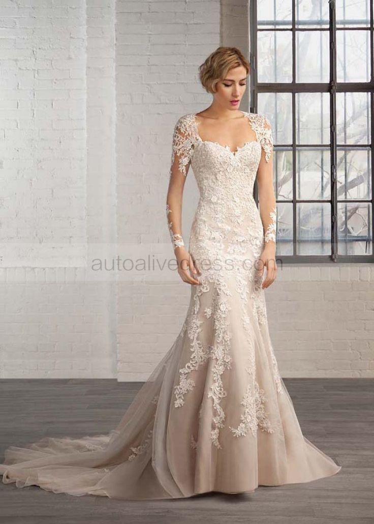 The dress is made of high quality of lace appliques and tulle fabric.The listed color is ivory with champagne lining.The neckline is sweetheart.It features the keyhole back.It has long sleeves as well.This dress is made in floor length with short train.Perfect for wedding,anniversary,banquet,prom or