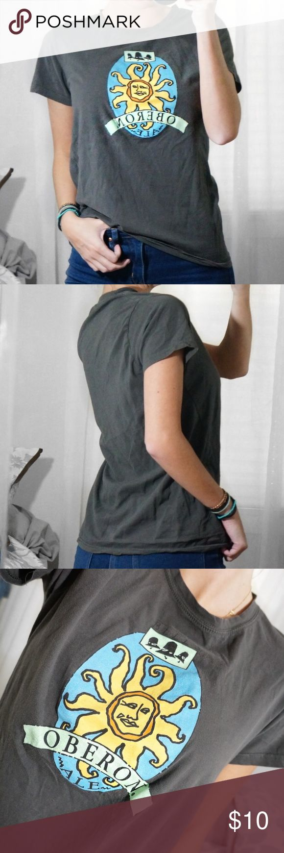 """Gray Oberon Beer Fitted Tee T-Shirt Serve up a stylishly simple look while supporting your favorite beer with this Gray Oberon Beer Fitted Tee! Ultra soft and lightweight stretch knit shapes this essential tee with a classic round neckline, short sleeves, and a relaxed yet flattering bodice. Excellent condition. Cant read the tag but fits as a size SM (could possibly fit a medium as well). I'm a size SM, 5'7"""", 32d modeling the fit. Tops"""