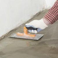 Many homeowners are opting for exposed concrete floors in their homes, because they can be attractive and are easy to keep clean. Before you can add a colored stain followed by a coating of epoxy, urethane or wax to make a concrete floor shine, you must prepare the floor's surface. A professional floor buffer or sander equipped with a sanding disc...