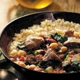 Crock Pot Middle Eastern Lamb Stew -- loaded with chickpeas, tomatoes, and spices. Serve this over quinoa for an easy but impressive Phase 3 dinner.