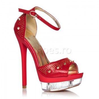 Sandalele Yvette sunt cu adevarat divine. Cu un toc de 16 cm si strasuri de diferite marimi, aceste sandale vor transforma orice tinuta intr-una spectaculoasa. Oriunde ati alege sa le purtati, veti da dovada de senzualitate si eleganta datorita frumosului rosu. Nimeni nu-si va lua ochii de la aceste sandale.