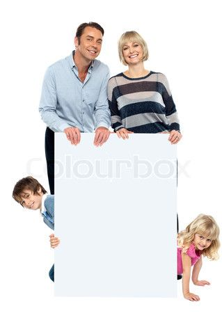 Image of 'Lively family of four all around blank whiteboard' on Colourbox