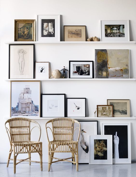 Small works of art and shelves create an interesting aesthetic.