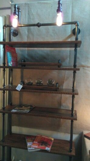 Our large book shelf with lights in action at our stall