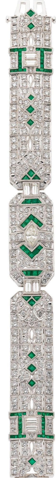 Diamond, Emerald & White Gold Bracelet. The bracelet features a marquise-shaped diamond, enhanced by full and baguette-cut diamonds, accented by square and triangular-shaped emeralds, set in 18k white gold. Total diamond weight is approximately 8.50 carats. Total emerald weight is approximately 2.00 carats.