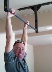 Crossfit founder greg glassman has a stud bar in his garage gym