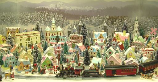 """These quaint little decorations, known as """"putz houses"""" or """"putzes"""", were found on tables, mantles and under Christmas trees in homes across America for many decades starting around the early 1900's."""