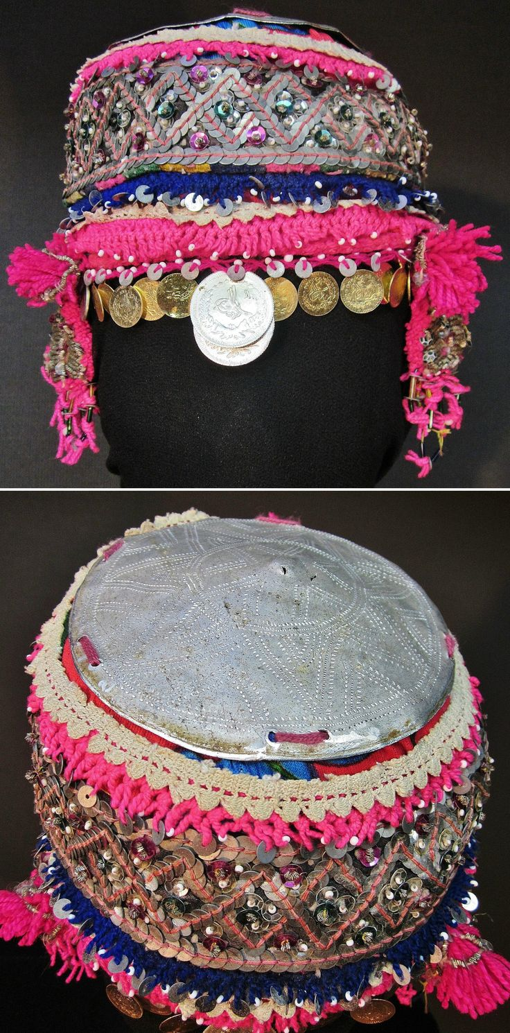 A traditional bridal/festive 'fes' (hat) from the Pomak villages near Biga (Çanakkale prov.), mid-20th c.  The cap is adorned with metal & mica sequins, small golden spirals, glass beads, metal (imitation) Ottoman coins, and (cotton or orlon) pom-poms.  (Inv.nr. ba$036  - Kavak Costume Collection - Antwerpen/Belgium).
