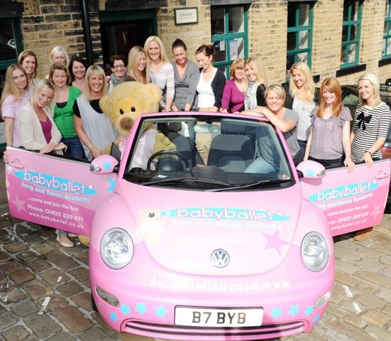 We're really pleased to have baby ballet with us - everyone loves their bear! Here are some of their franchisees outside babyballet Head Office in the baby ballet car with Twinkle the bear....