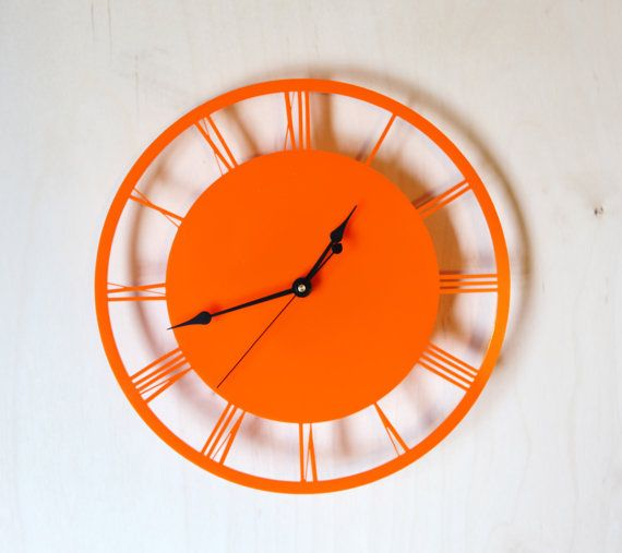 Gotta have the orange clock for Dwight's clock wall......It's going to be like a picture frame collage wall, only with clocks......it's going to be AWESOME!