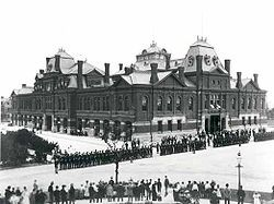 During a severe depression (the Panic of 1893), the Pullman Palace Car Company cut wages as revenue dropped so 4,000 Pullman factory workers went on strike demanding higher wages, lower rent, and better working conditions. The company owner, George Pullman, refused or go to arbitration. President Grover Cleveland deployed 12,000 troops to break the strike; 30 strikers were killed and 57 were wounded. Cleveland designated Labor Day as a federal holiday 6 days after he quashed the strike.