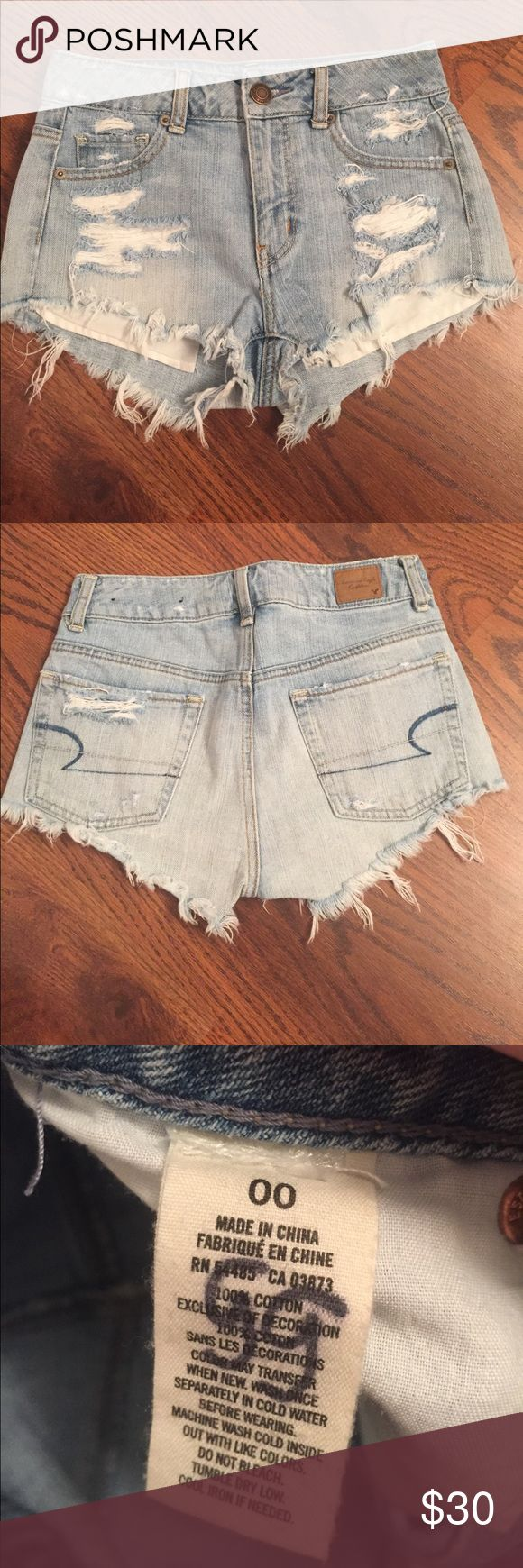 American Eagle High Wasted Ripped Denim Shorts American Eagle high wasted ripped denim shorts. Inner label has my initials written in them but overall great condition. From a smoke free home.  Feel free to comment with any questions or to make me an offer! American Eagle Outfitters Shorts Jean Shorts