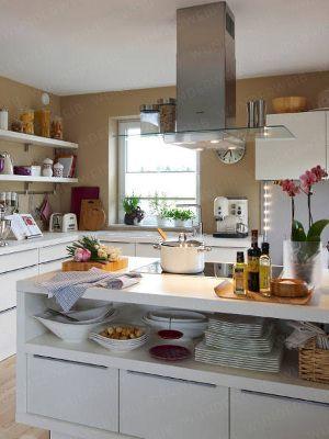 Hier wird nicht einfach nur gekocht: Diese Küche vereint Funktionalität und höchsten Profistandard mit dem Wunsch nach mehr Gemütlichkeit.