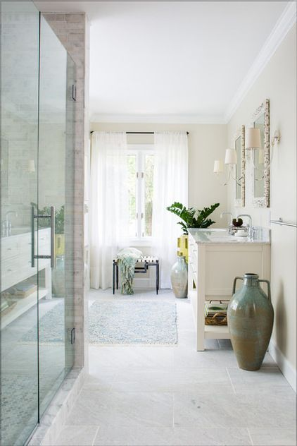 """For the floor, the designer chose a reasonably priced stone that looks expensive, from Porcelanosa. In addition to helping them stay within budget, the choice warms up the room. """"Too much marble can be harsh sometimes,"""" she says."""