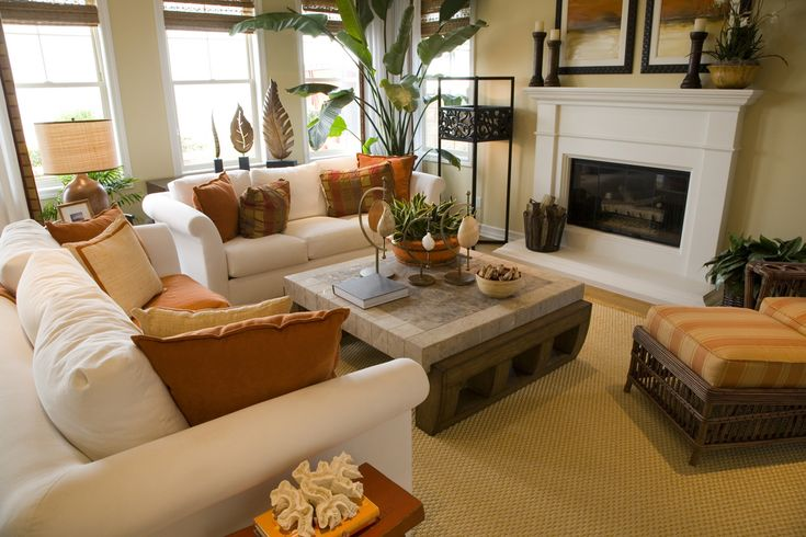 This arrangement with two love seats and one chair might work. Side tables near most seating positions make it liveable