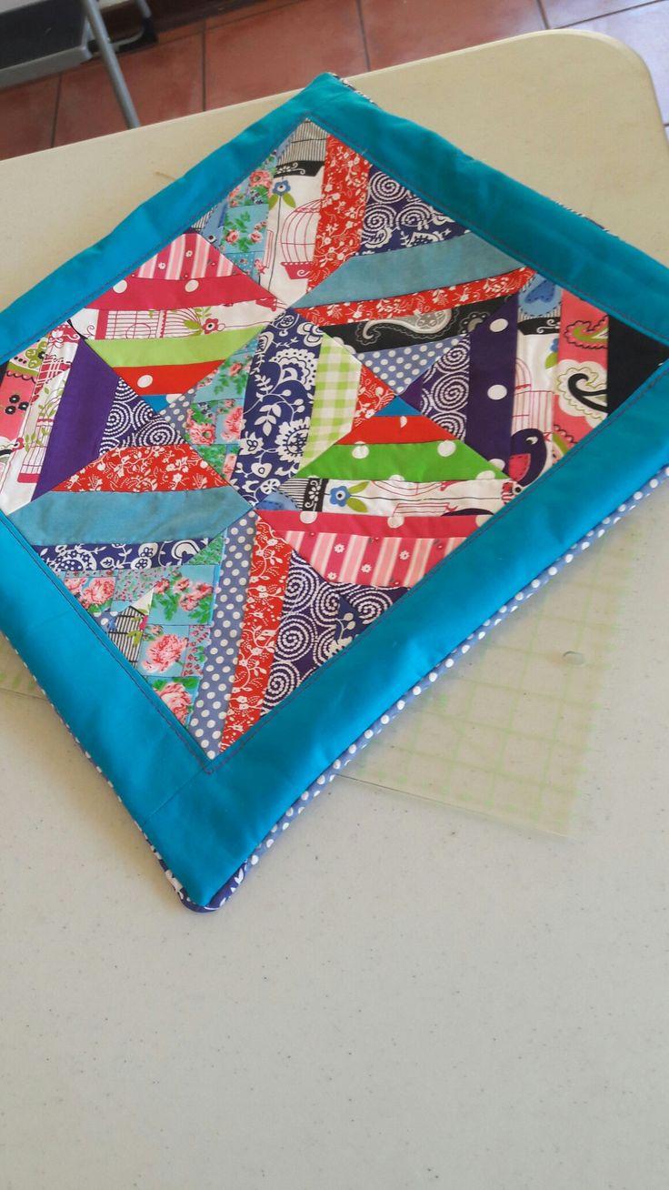 Strip quilt with scraps