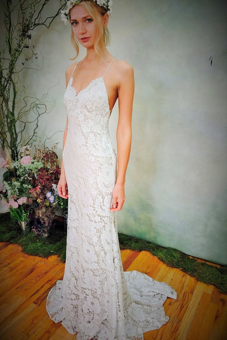 Elizabeth Fillmore Known for her vintage-inspired gowns, Elizabeth Fillmore offers up this lacy slip with a dramatic, low back — the type of piece you'd imagine a yoga-toned bride would wear while getting married barefoot on the beach.