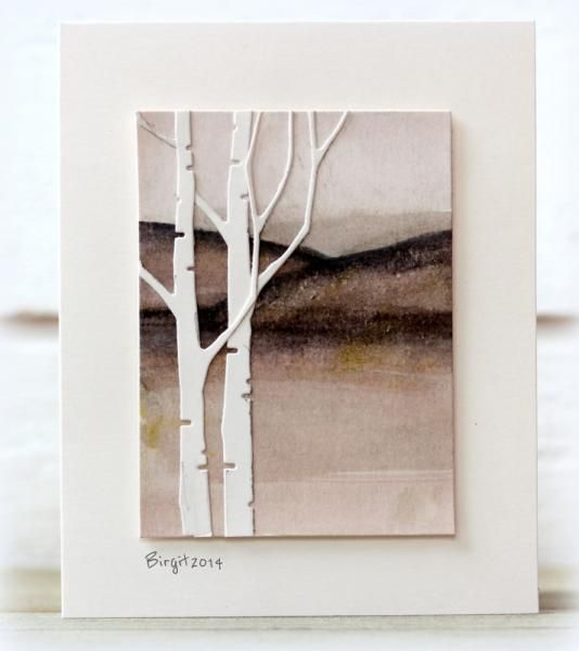 handmade card: JUN14VSNG Mountains by Biggan ... stark fall scene in watercolored browns ... white die cut birch trees ... luv how Birgit raised the main panel to make it look more like the modern framed art piece it is ...